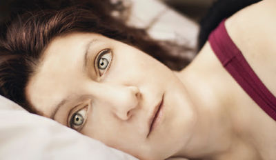Woman struggling with insomnia.