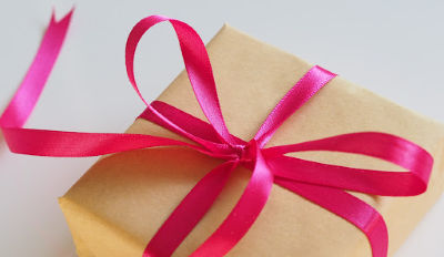 After divorce gift wrapped in brown paper and tied with a pink ribbon.