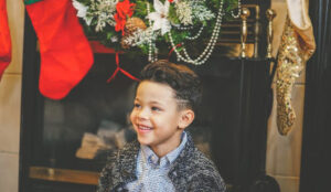 Little boy smiling for his Christmas picture.