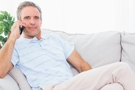 man on couch talking