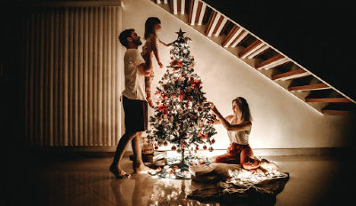 Couple decorating the tree with their daughter despite their marriage being over.