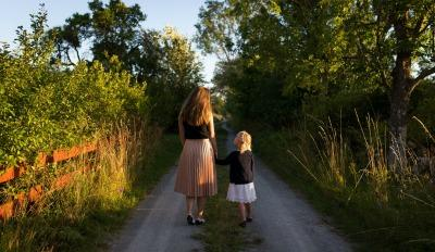 Mother and daughter walking and dealing with grief while discussing heartbreak.