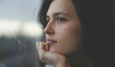 Woman thinking about her grief of divorce.