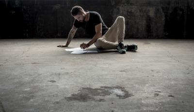 Man absorbed in working on his plan for healing after divorce.