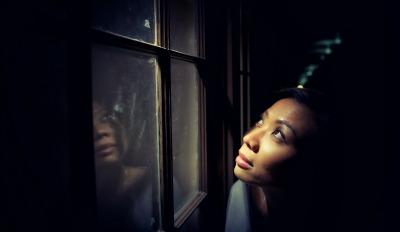 Woman looking out the window wondering how to trust again after her divorce.