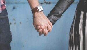 Couple holding hands as they embark on their adventures dating after divorce.