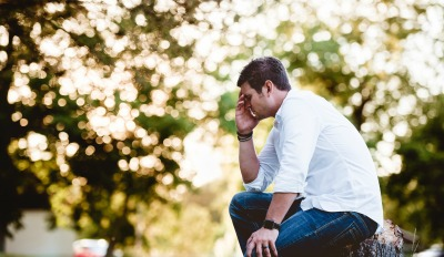 Man thinking about cheating to get out of a relationship.