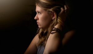 Woman lost in thought about how infidelity changes you.