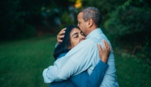 Woman embracing her husband after discovering how to get over an affair your husband had.