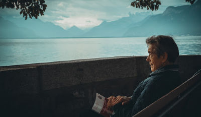 Man looking out at a lake wondering how to get over a divorce and an affair.