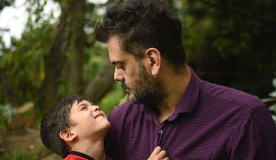 Man looking at his son wondering why co-parenting doesn't work for him and his ex.
