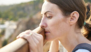 Woman looking over the landscape wondering what to do about her miserable second marriage.