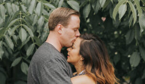 Married couple hugging under a tree after discovering how to fix an unhealthy marriage.