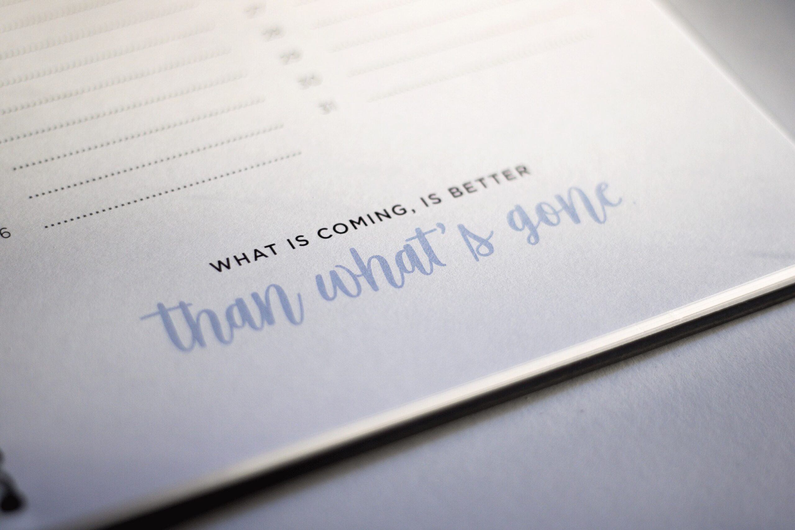 Notepad with one of the best life-after-divorce quotes: What is coming, is better than what's gone.
