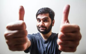 """Man giving 2 thumbs up because he can say, """"My life got better after divorce."""""""